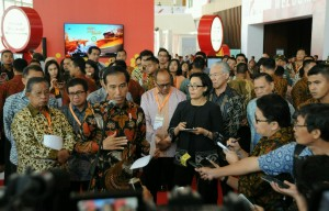 Photo caption: President Jokowi answers reporters' questions after the opening of the IFFC at ICE, BSD, Tangerang, Banten, Tuesday (30/8) (Photo by: Public Relations Division/Jay)