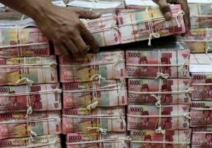 Tumpukan-uang-100-ribuan