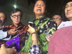 Photo caption: Commissioner of National Commission on Human Rights M. Imdadun Rahmat responds to reporters questions after meeting President Jokowi on Friday (9/12)