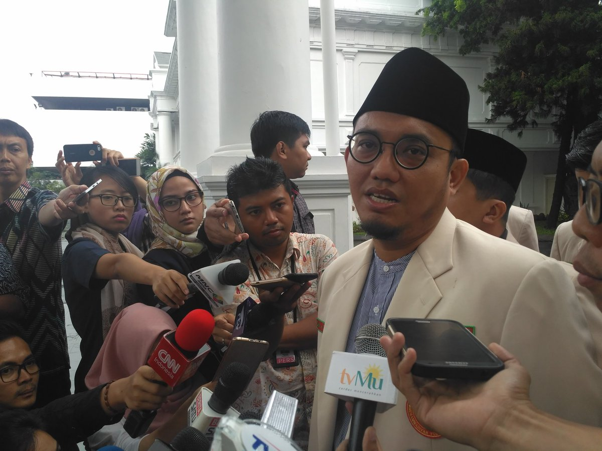 Chairman of the Muhammadiyah's Youth Wing Dahnil Anzar Simanjuntak answers reporters after meeting with President Jokowi, at the Presidential Palace, Jakarta, Monday (20/2) afternoon.