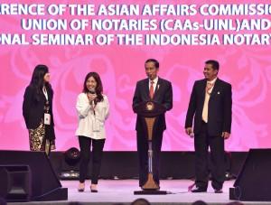 Presiden Jokowi saat menghadiri Seminar Internasional Ikatan Notaris Indonesia, di Bali Nusa Dua Convention Center, Bali, Jumat (8/9) sore. (Foto: Humas/Anggun)