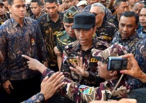 Presiden Jokowi saat menghadiri acara di lapangan silang Monas, Jakarta, Sabtu (9/12). (Foto: Humas/Agung)