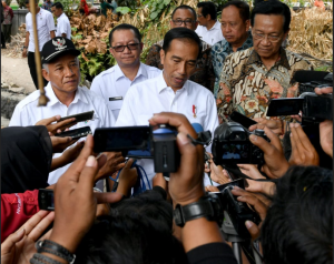 President Jokowi answers reporters' questions after inspecting the Village Fund project, in Sendangtirto Village, Sleman Regency, DIY, Wednesday (29/8). (Photo by: BPMI Setpres)