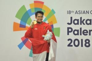 Komang Harik Adi Putra  pada partai final sejumlah nomor yang digelar di Padepokan Pencak Silat, Taman Mini Indonesia Indah (TMII), Jakarta, Senin (27/8). (Foto: Humas/Jay).