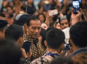 Presiden Jokowi menjawab wartawan usai membuka Kongres XXXVI GAMKI, di Bogor, Jabar, Jumat (14/9) pagi. (Foto: Agung/Humas)