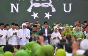 Presiden Jokowi dan Ibu Negara Iriana Joko Widodo menghadiri Peringatan Maulid Nabi Muhammad SAW dan Hari Lahir Ke-73 Muslimat Nahdlatul Ulama (NU) serta Doa untuk Keselamatan Bangsa, di Stadion Utama Gelora Bung Karno (SU GBK), Jakarta Pusat, Minggu (27/1) pagi . (Foto: Rahmat/Humas)