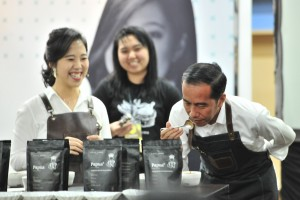 President Jokowi smells the aroma of coffee displayed in a booth, at the opening of the 2019 Skills Festival, at Kota Kasablanka, Jakarta, Saturday (9/2). (Photo by : Jay/ PR Division)