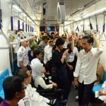 President Jokowi talks to a person with disability in Jakarta MRT, Thursday (21/3). Photo by: Jay/PR