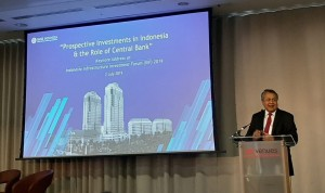 Governor of Bank Indonesia Perry Warjiyo delivers his statement at the 2019 Indonesia Infrastructure Investment Forum (IIIF), in London, England, Tuesday (2/7). (Photo by: BIO Depkom)