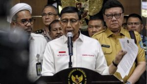 Political, Legal and Security Coordinating Minister Wiranto delivers a press statement related to developments in Papua, at the Office of Coordinating Ministry for Political, Legal and Security Affairs, Jakarta, Monday (19/8). (Photo by: Coordinating Ministry for Political, Legal, and Security Affairs PR)
